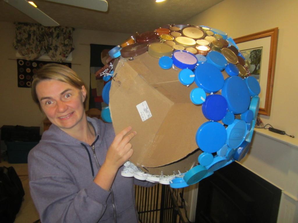"Plastic cap globe showing cardboard ""ribs"""