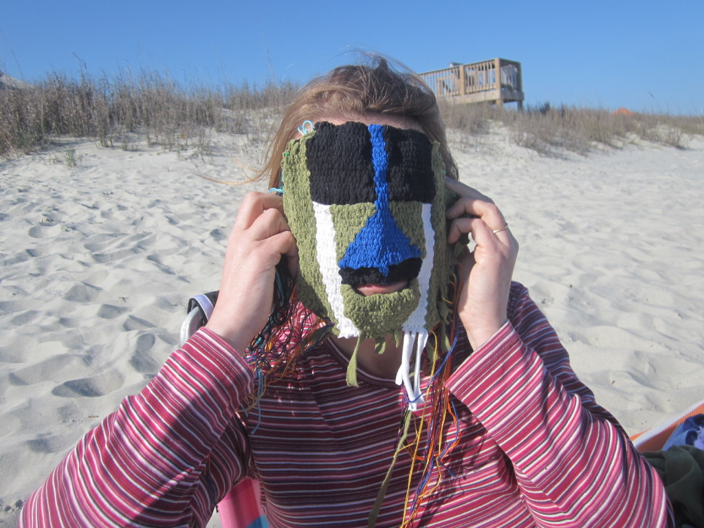 Carla tries on the mask at the beach