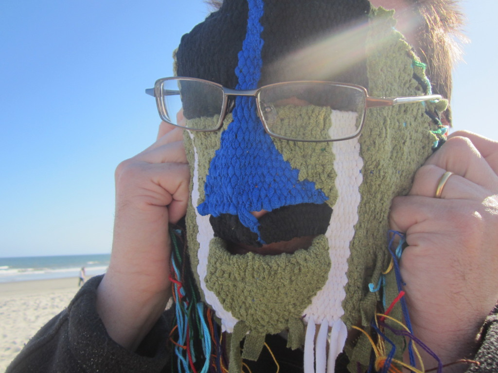 Bob tries on the mask at the beach