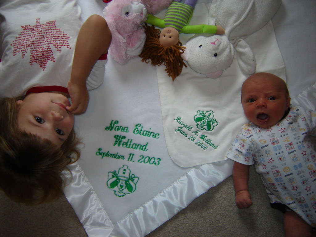 With their commemorative baby blankets