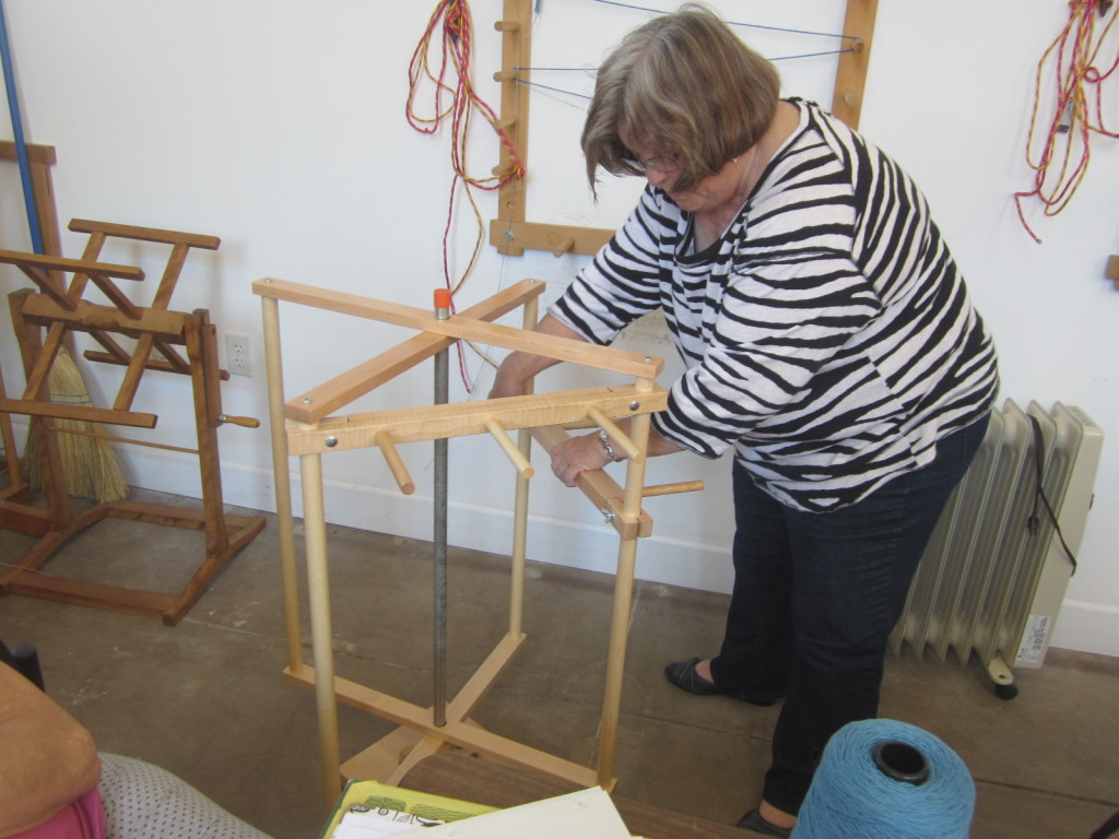 Marilyn setting up a vertical warp mill