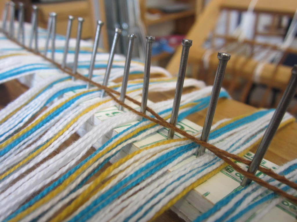 Keeping the warp on the rattle - tying it down with some yarn or rubber bands