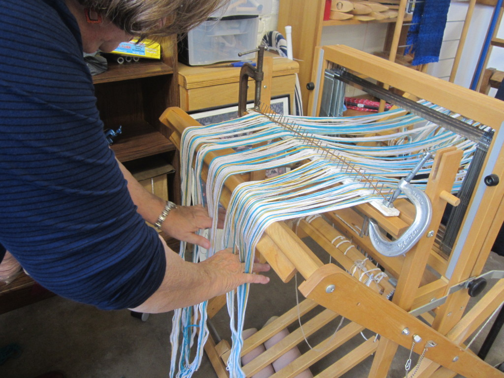 Straightening out the warp - NOT combing, but putting your weight on the warp