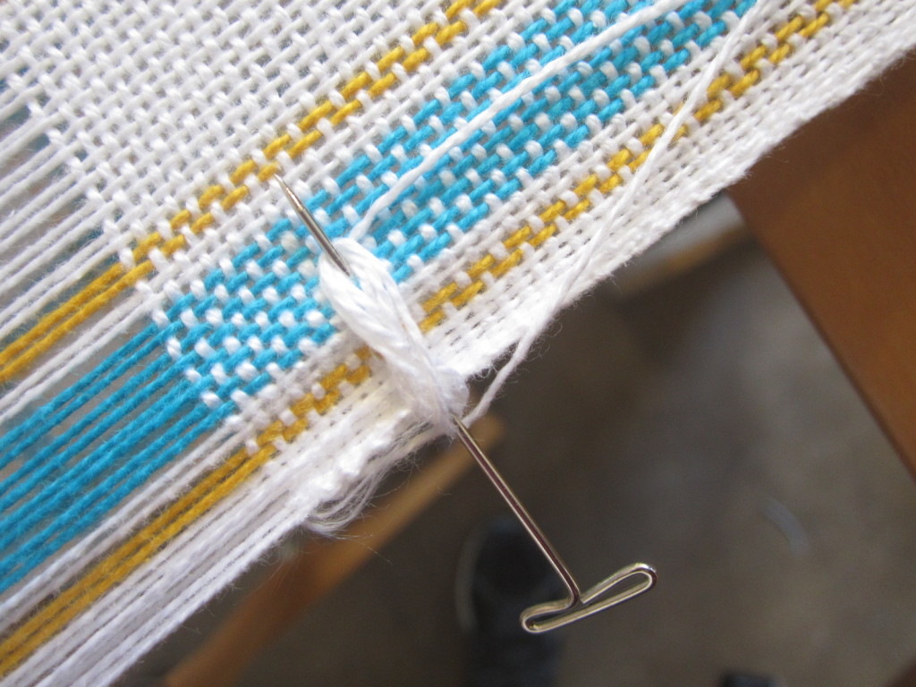 Wrapping the new warp thread around the pin in a figure 8