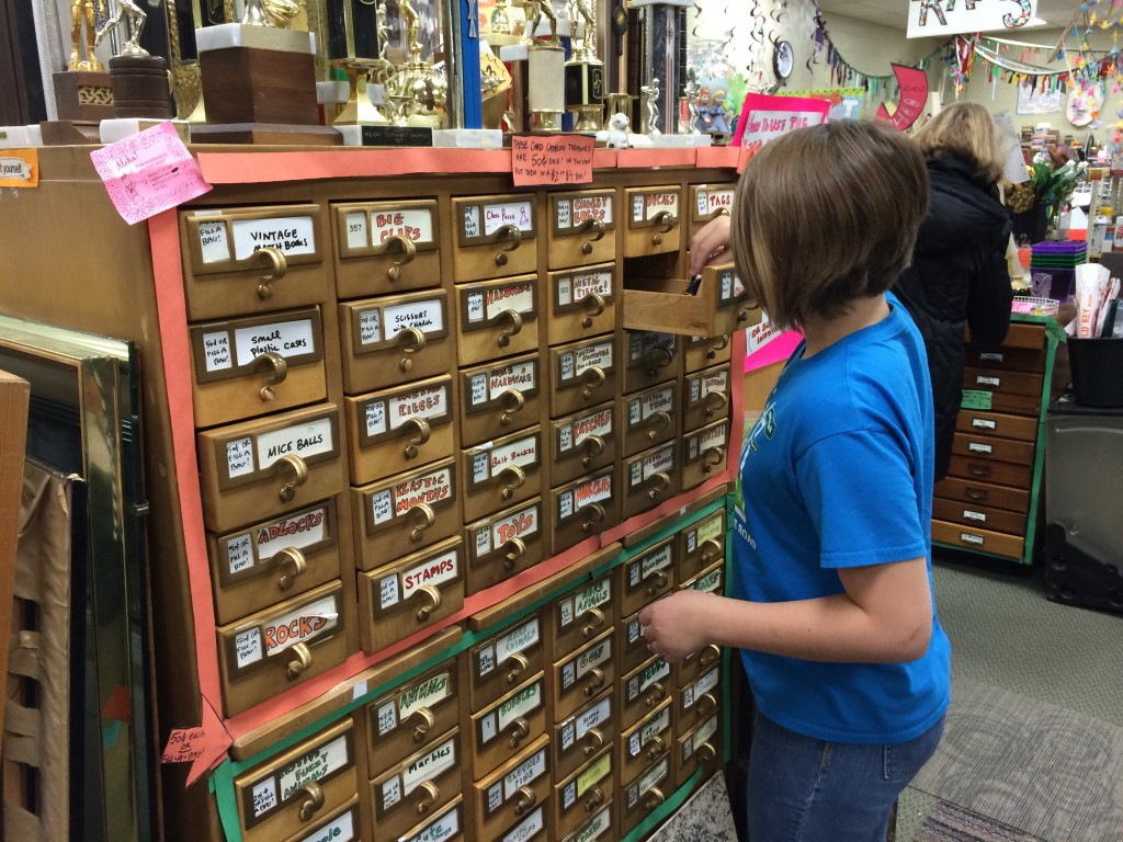 Nora explores the old card catalog drawers full of goodies