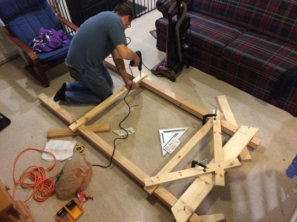 Bob drills holes to make the Story Loom