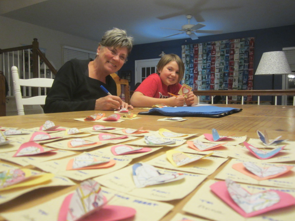 Nana & Nora making recycled map valentines