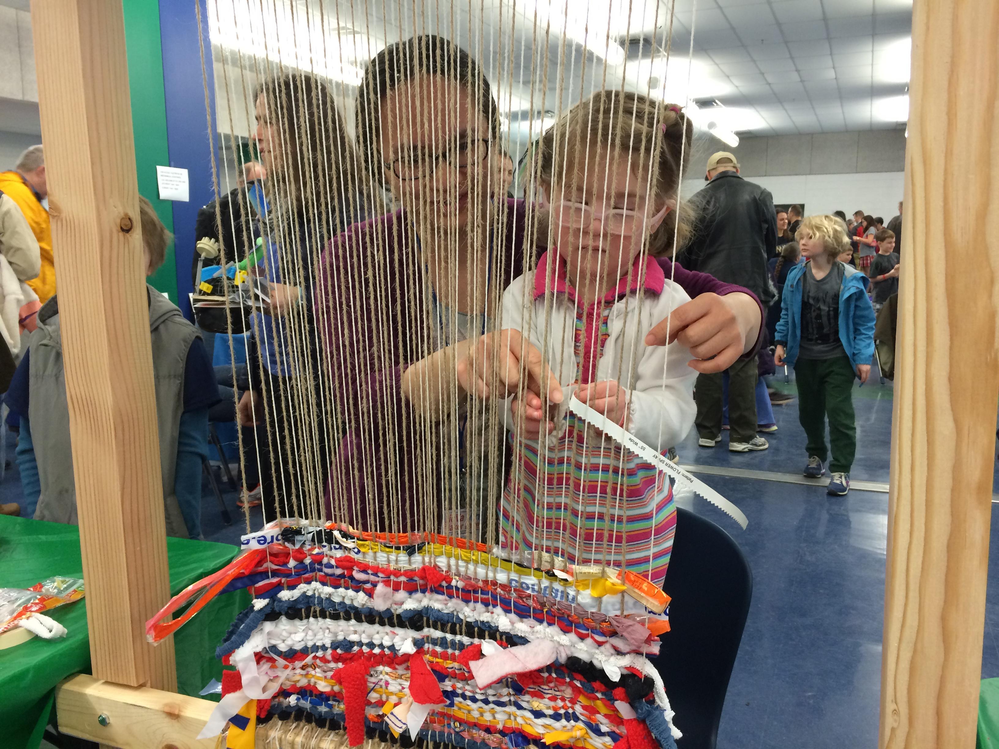 Karen helps a keen weaver