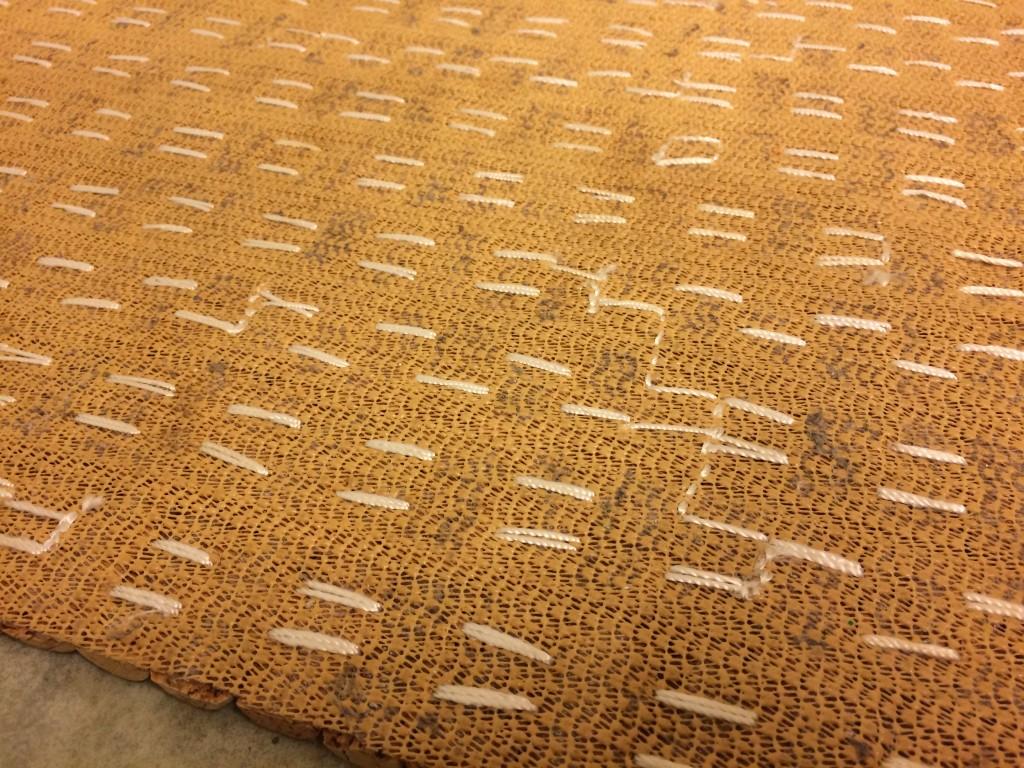 Stitching under the wine cork mat