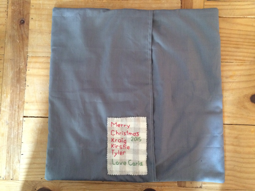 Back of the pillow, showing flap closure and label