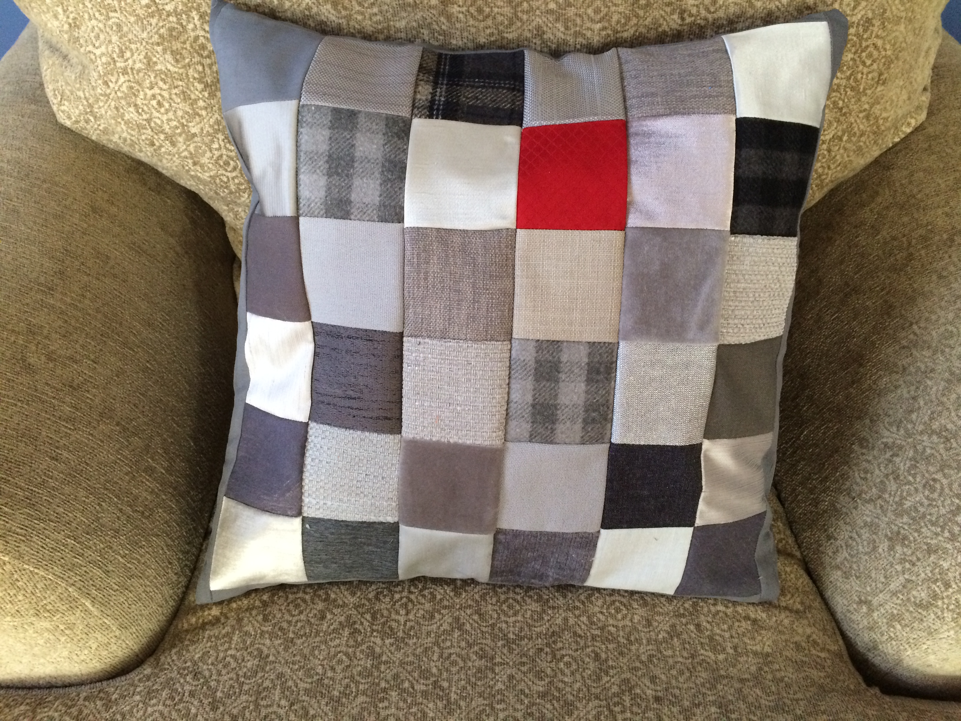 Completed pillow from upholstery scraps