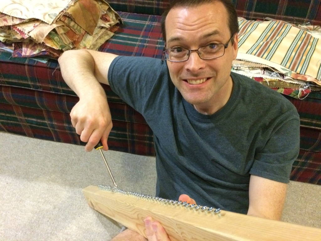 Bob adding screws to my Story Loom to make warping go faster