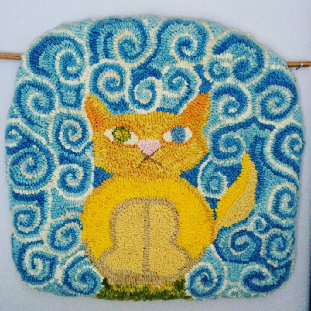 Kitty rug hooked from my daughter's drawing, inspired by the cat in the movie The Secret of Kells. The cat's name is Pangur Ban.
