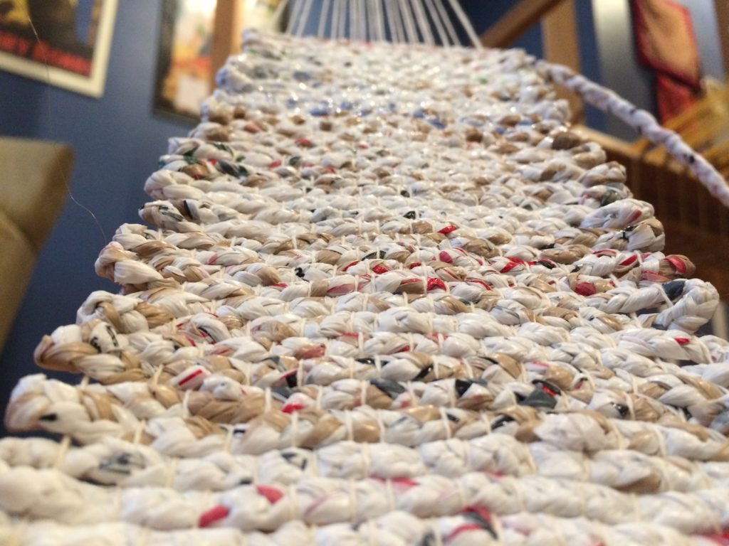Weaving white plastic bags