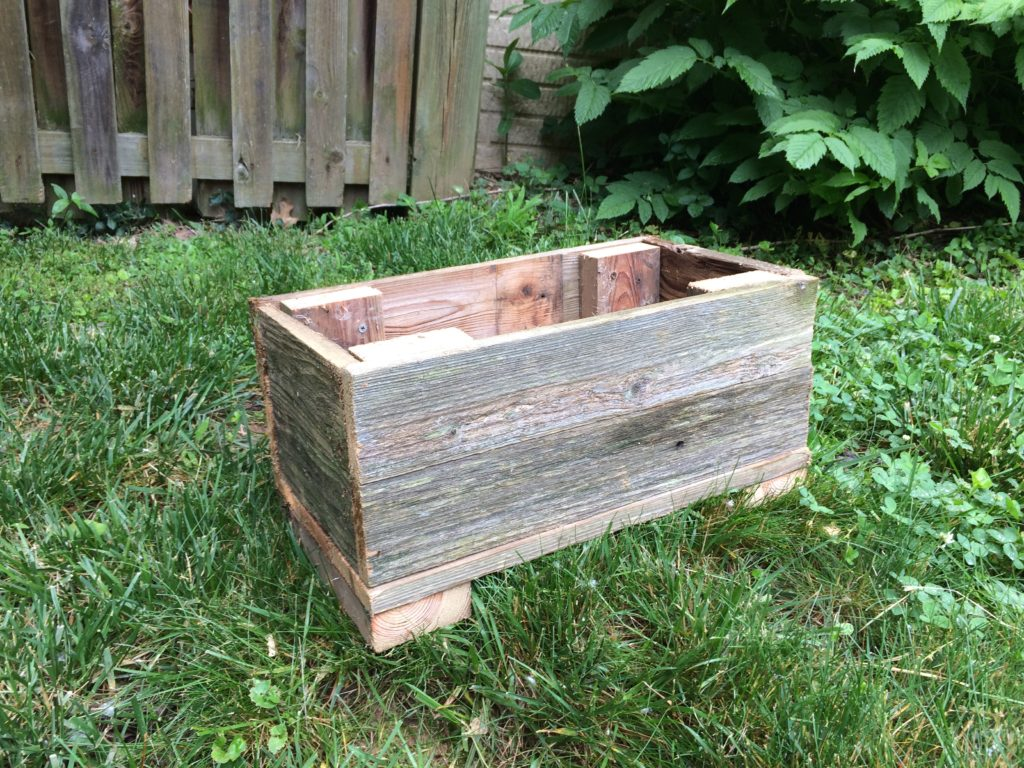 Planter box from recycled fence wood