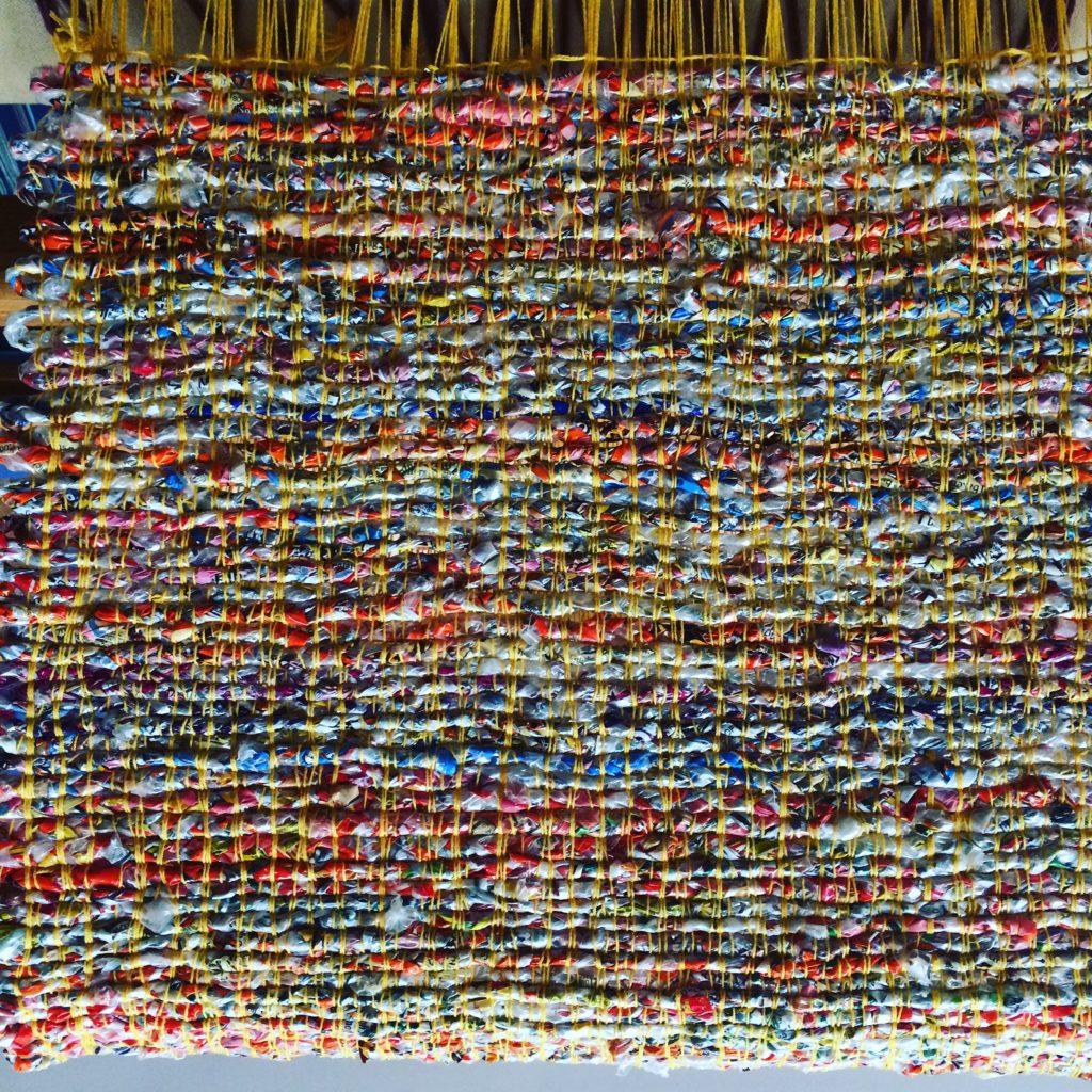 Woven plastic bag mat