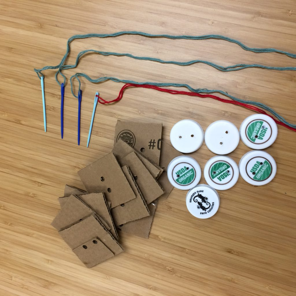 "Sewing plastic cap ""buttons"" on cardboard - creative reuse station"
