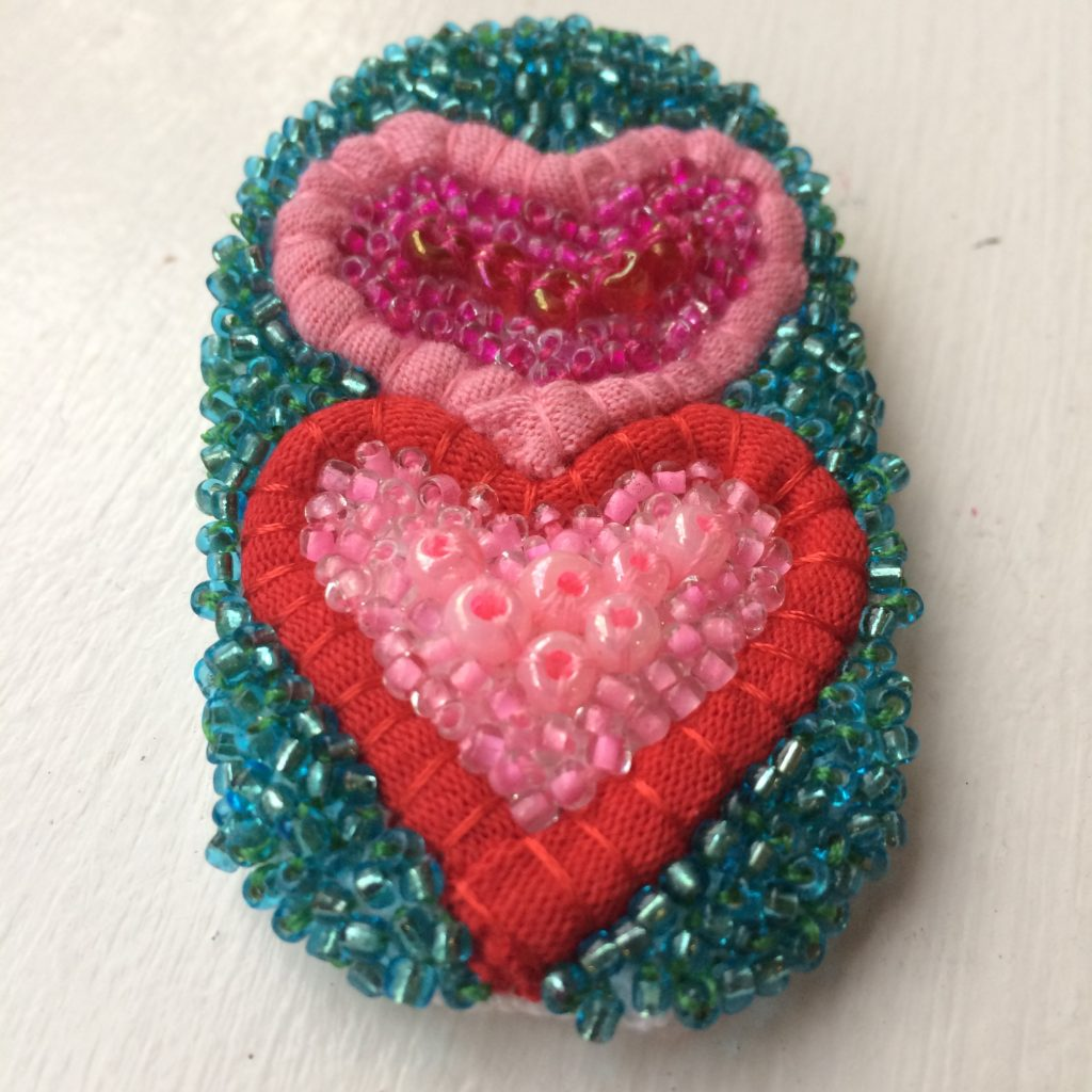 Valentine's broach made from recycled t-shirt yarn and beads