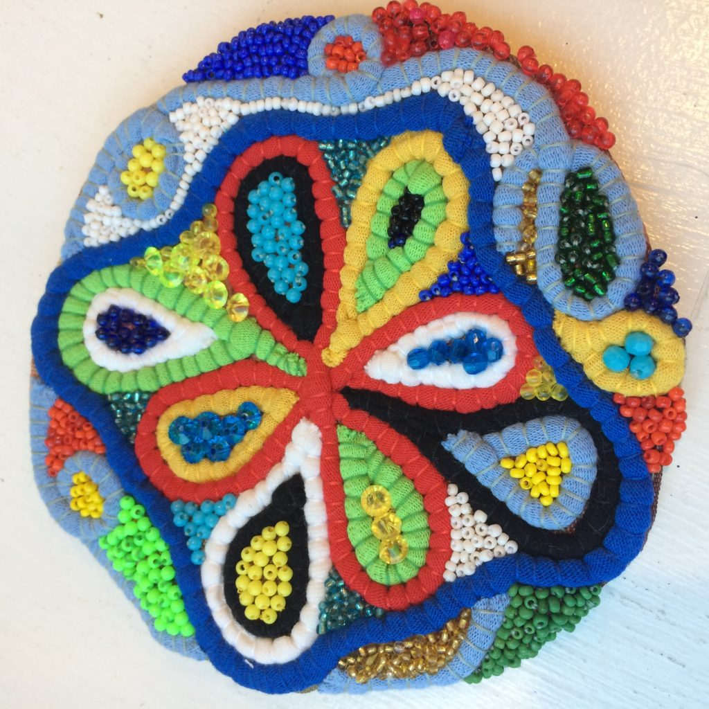 """Medallion"" embroidery made from recycled t-shirt yarn and beads"