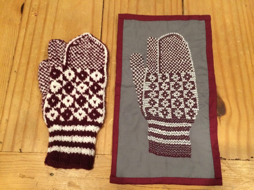 My mitten embroidery beside the Newfoundland double-knit trigger mitten that inspired it