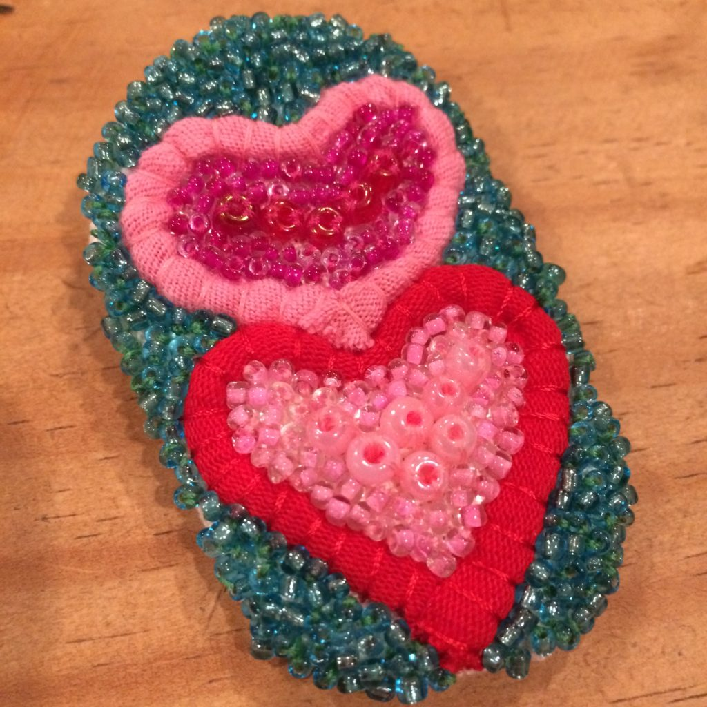 Valentine's broach made from recycled t-shirt strips and beads, February 2018