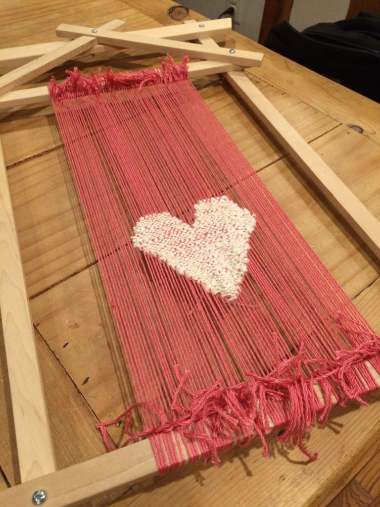 Handwoven heart cushion on my hand loom