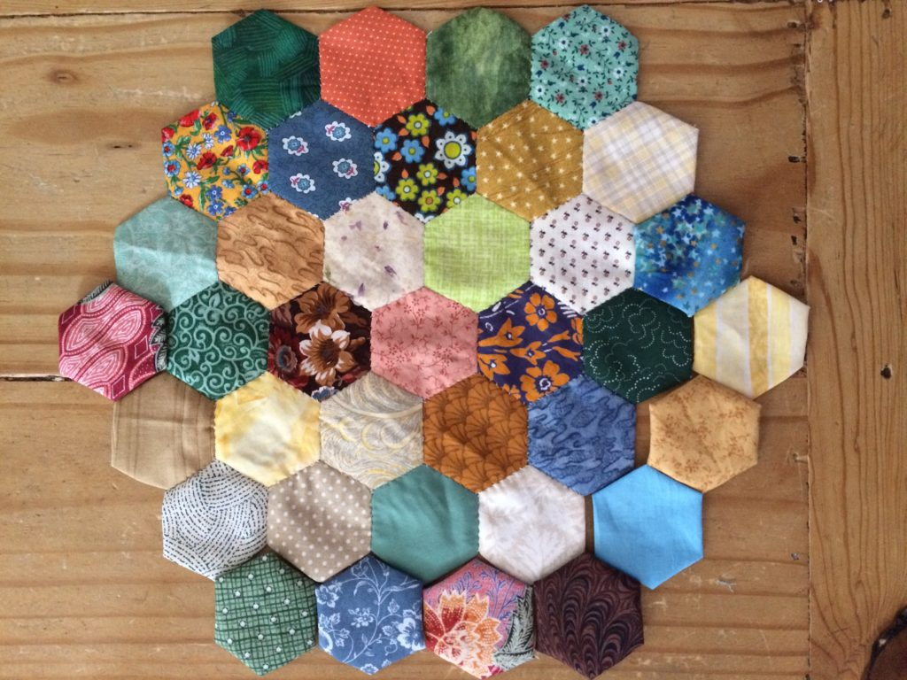 Hexagon paper-pieced quilt by Trashmagination, March 2017