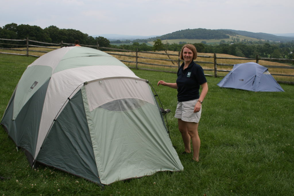 Putting up our tent in a field, June 2011