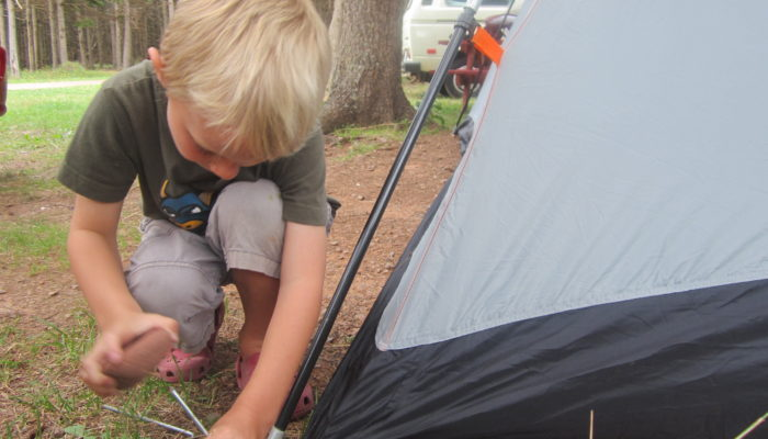 My son helping to put up our tent, August 2012
