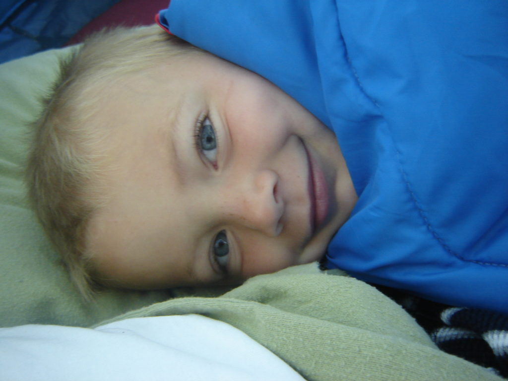 My son waking up in a tent, August 2010