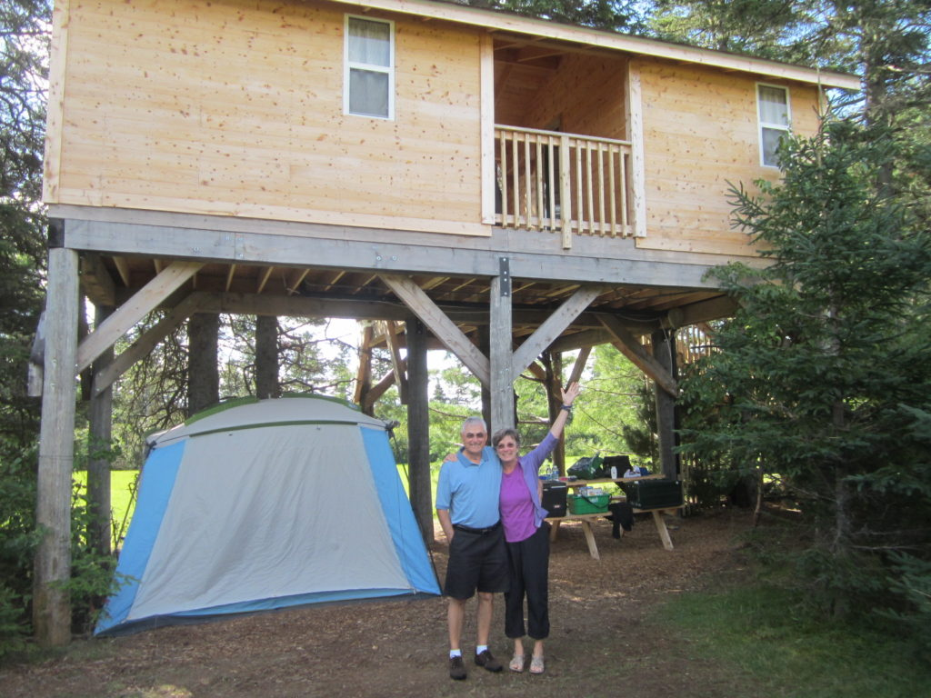 Treehouse where we camped in New Brunswick - August 2014 - Those are my parents - we had a screen tent underneath for cooking to keep blackflies away