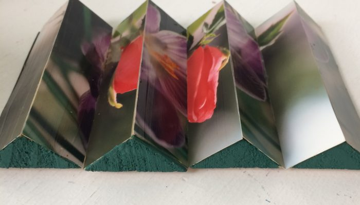 Lenticular photo display made from clementine box triangles by Trashmagination
