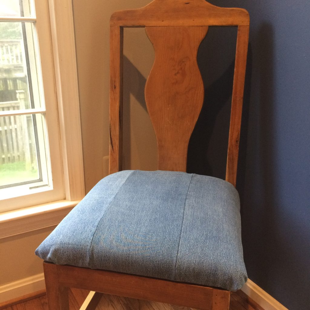Dining room chair reupholstered with denim jeans by Trashmagination