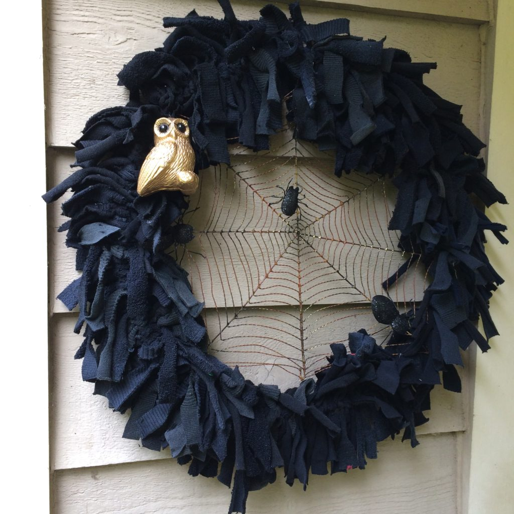 Halloween wreath made from recycled black socks designed by Trashmagination