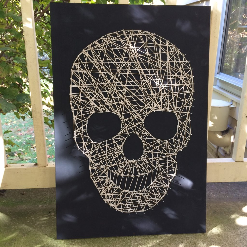 Thread-and-nail skull decorations inspired by the blog A Beautiful Mess