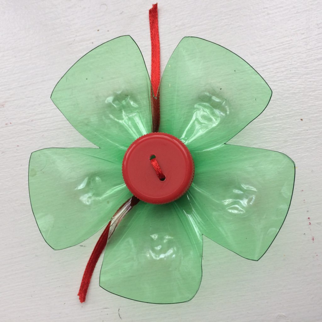 "Decorative gift ""bow"" made from a recycled green soda bottle and cap"