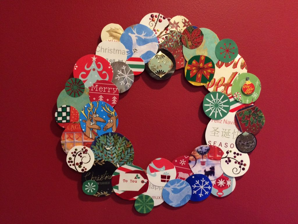 Wreath made from recycled holiday card circles pasted on cardboard circle by Trashmagination