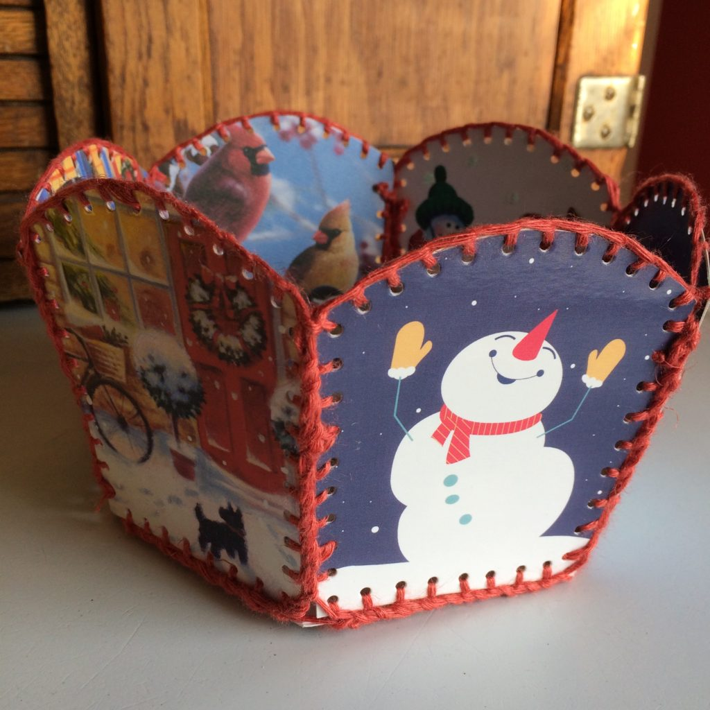 Holiday card basket sewn from recycled holiday cards and warp ends by Trashmagination