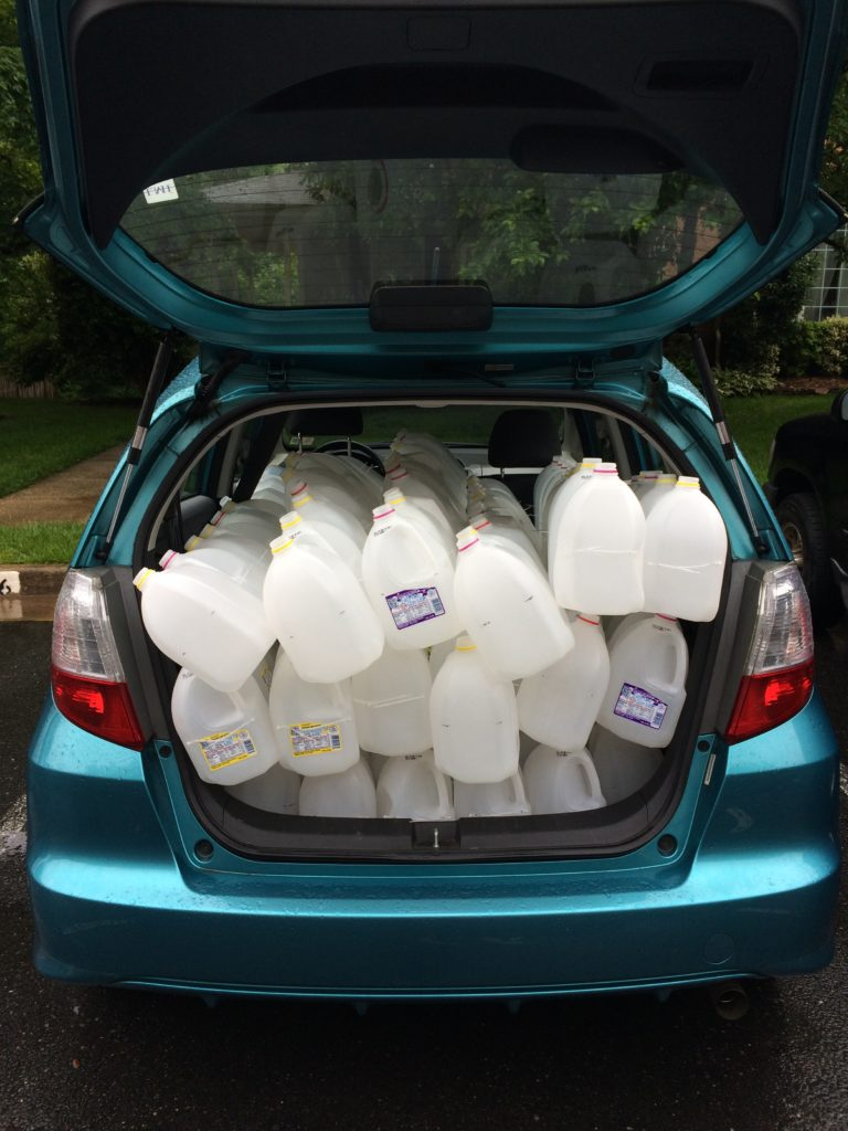 "My car filled with milk jug ""snakes"" - testing to see how many we could fit"