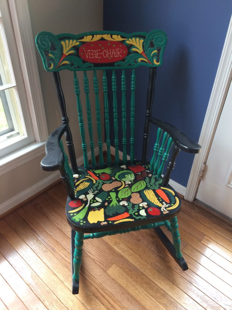 Rocking chair colorfully painted with vegetables - called the Vegechair