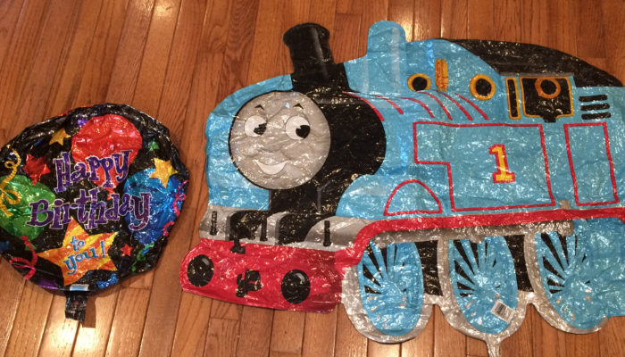 Mylar Balloons - round one says Happy Birthday to you and the other looks like Thomas the Train