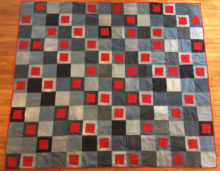 Weighted Blanket sewn by Trashmagination from recycled denim jeans and red wool coat