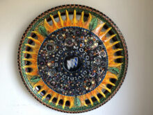 Hub cap art by Sharon Zigrossi from Blooming Hub Caps