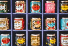 Tea tins on square shelves by Jonathan Kemper, Unsplash