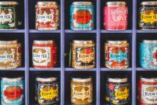 Tea tins on square shelves by Jonathan Kemper, Unsplash